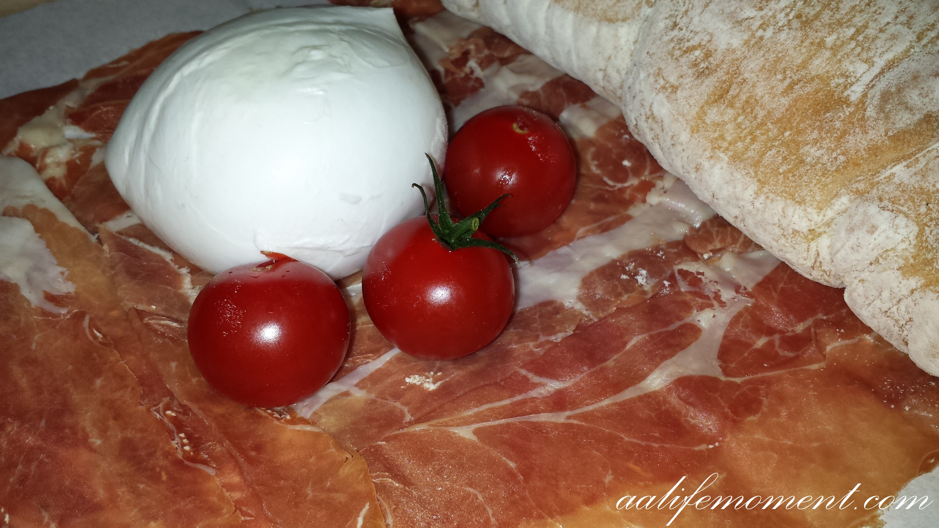 Cherry tomaotes,Mozzarella di Bufala, Parma Ham and Organic bread